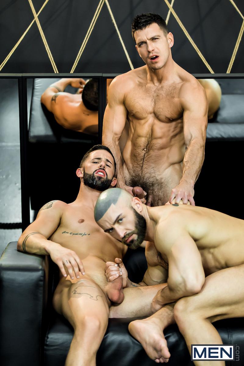 three muscled men cum