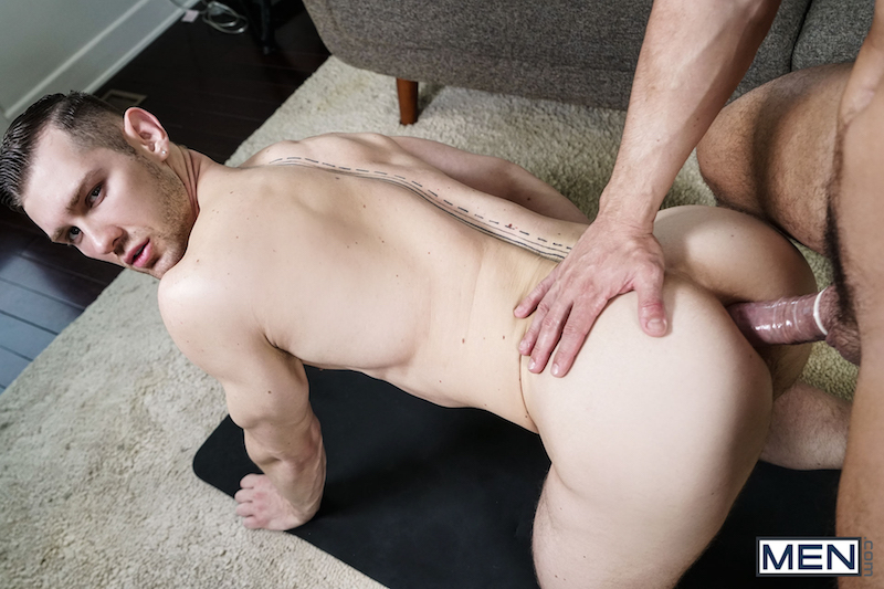jock kneels to take a cock in his ass