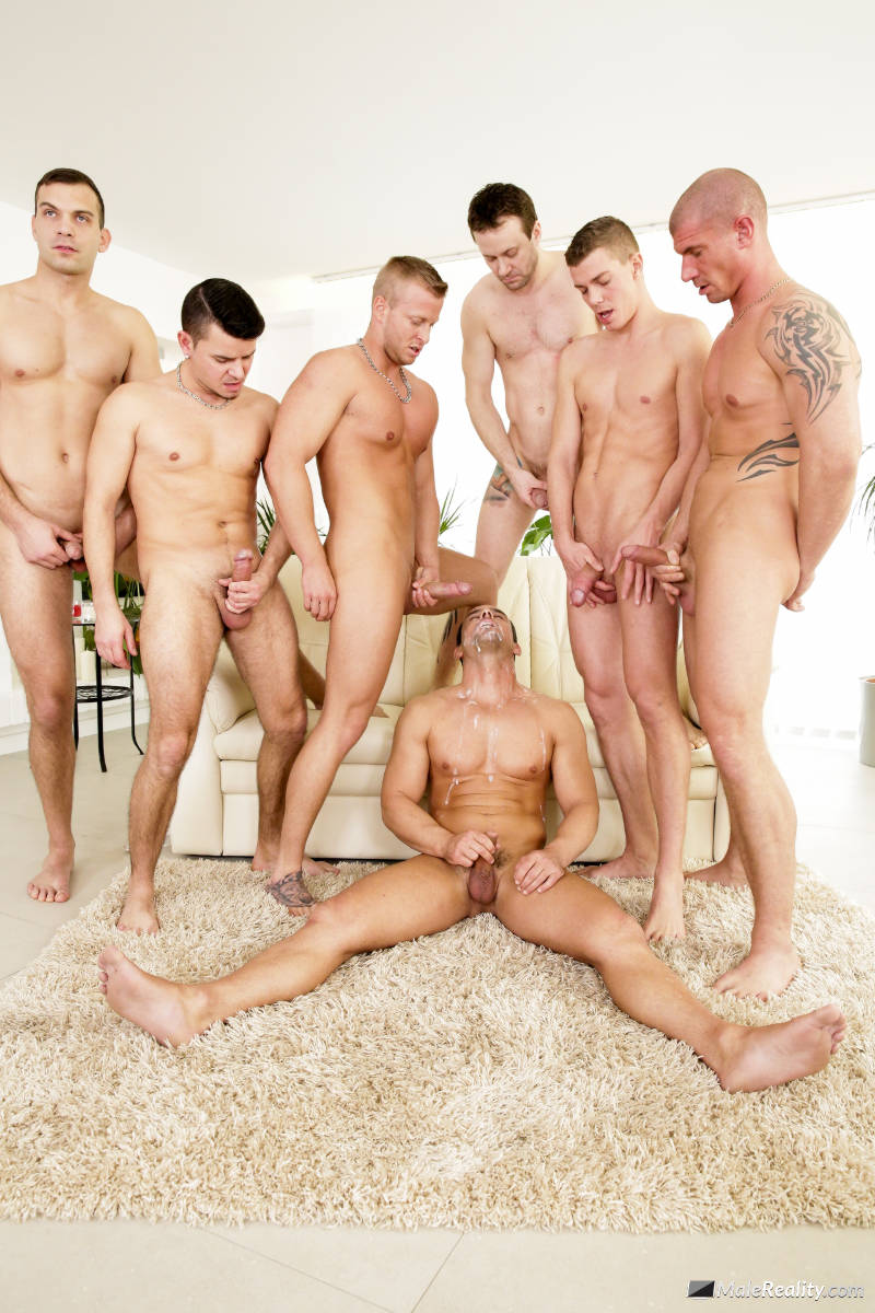gang of men jerking off over another man