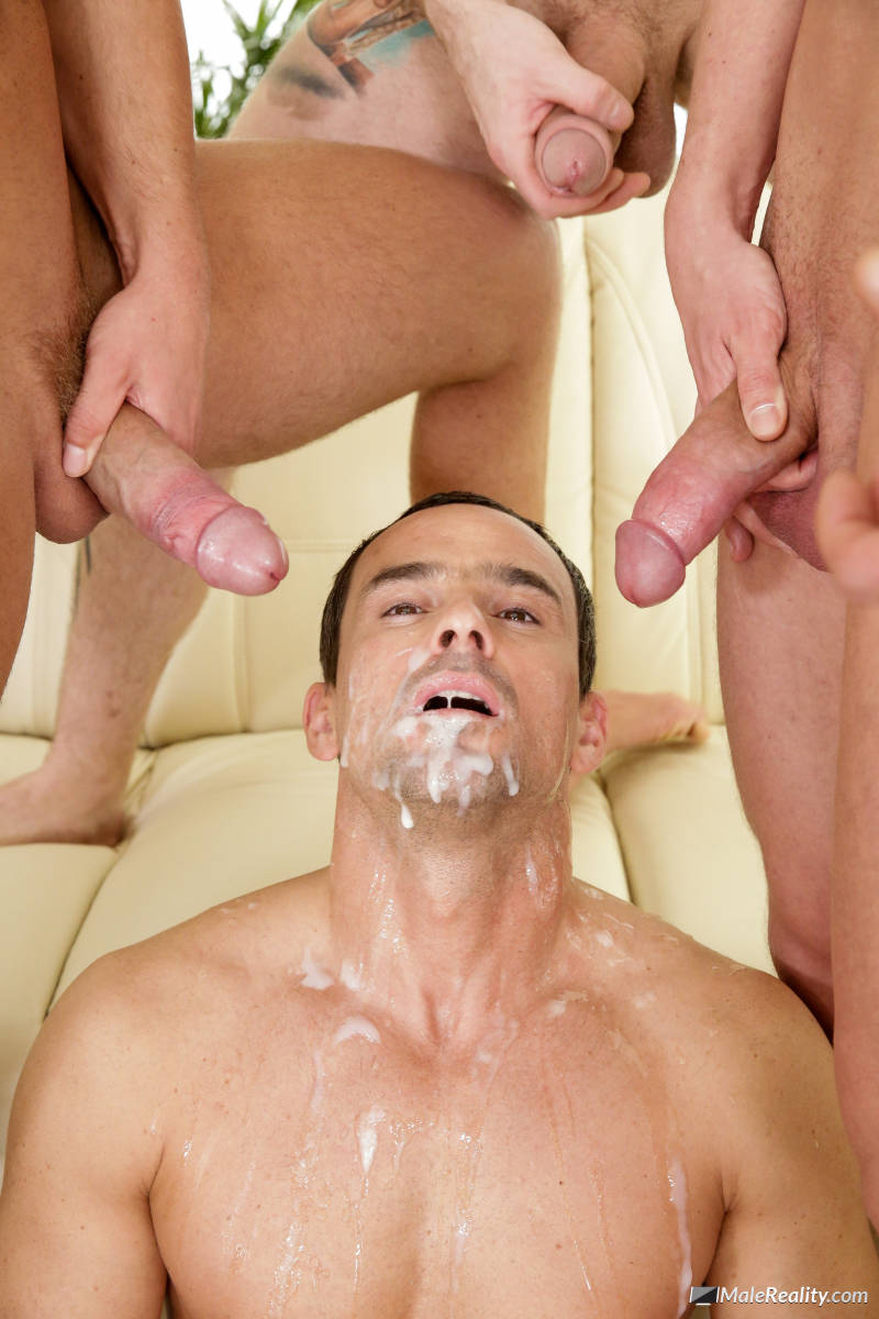 two cocks cumming in a guys face