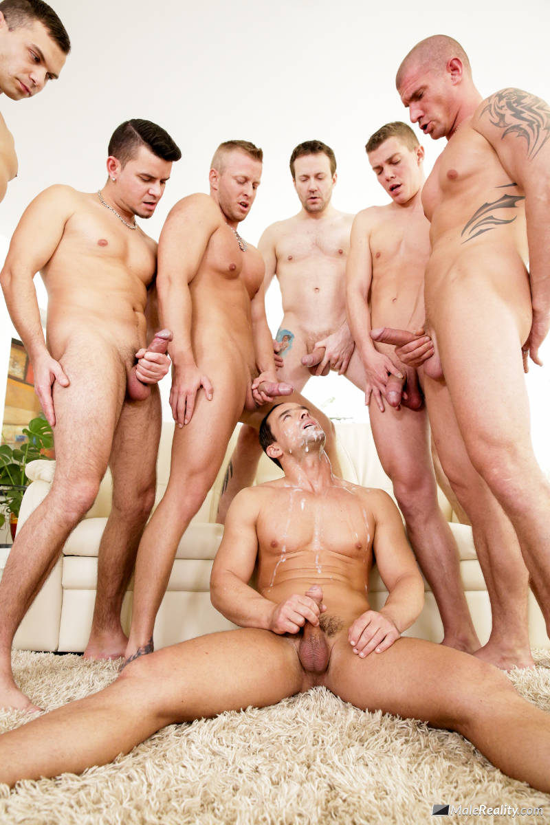 gogeous guy being cummed on by a gang of men